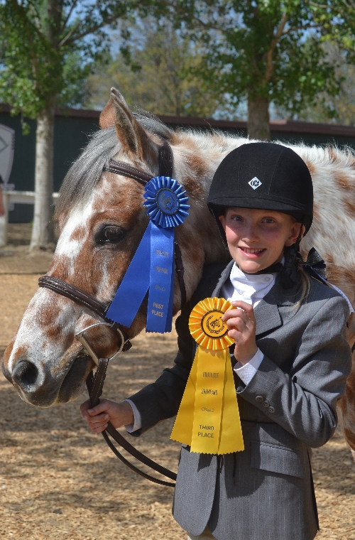Depicted is Giulia Lancellotti and her leopard appaloosa, Spot In My Heart  - 20167Equestrian Cover Contest Winner