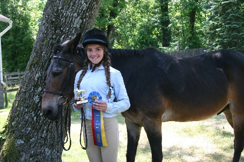 Jackson and Kaitlyn DeLeo are pictured with Hodges Badge Company, Inc. Empire rosette and trophy