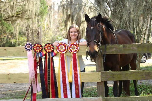 Tres Chic and Rebekah are pictured with Hodges Badge Company, Inc. Newton, Guernsey and Sunburst rosettes.